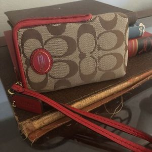 Brown and Red Coach Wristlet